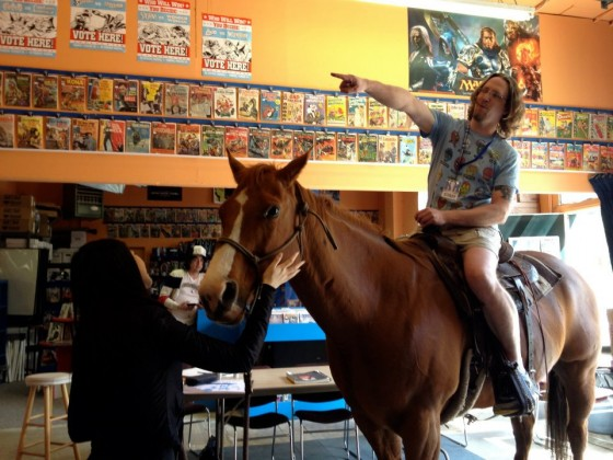 Jay Bardyla on a horse, in his store.